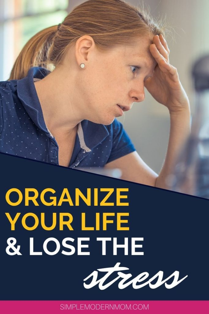 stressed out woman with hand on head, wearing blue shirt; organize your life and lose the stress