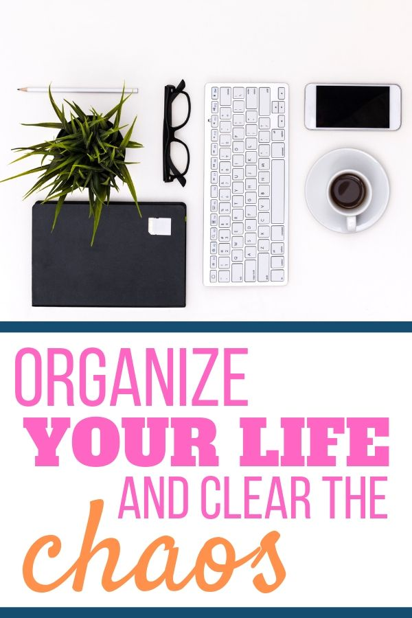 organized desk with book glasses pencil plant keyboard phone and coffee. organize your life and clear the chaos