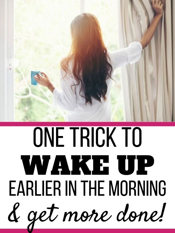woman looking out window in the morning drinking coffee, one trick to wake up earlier in the morningri
