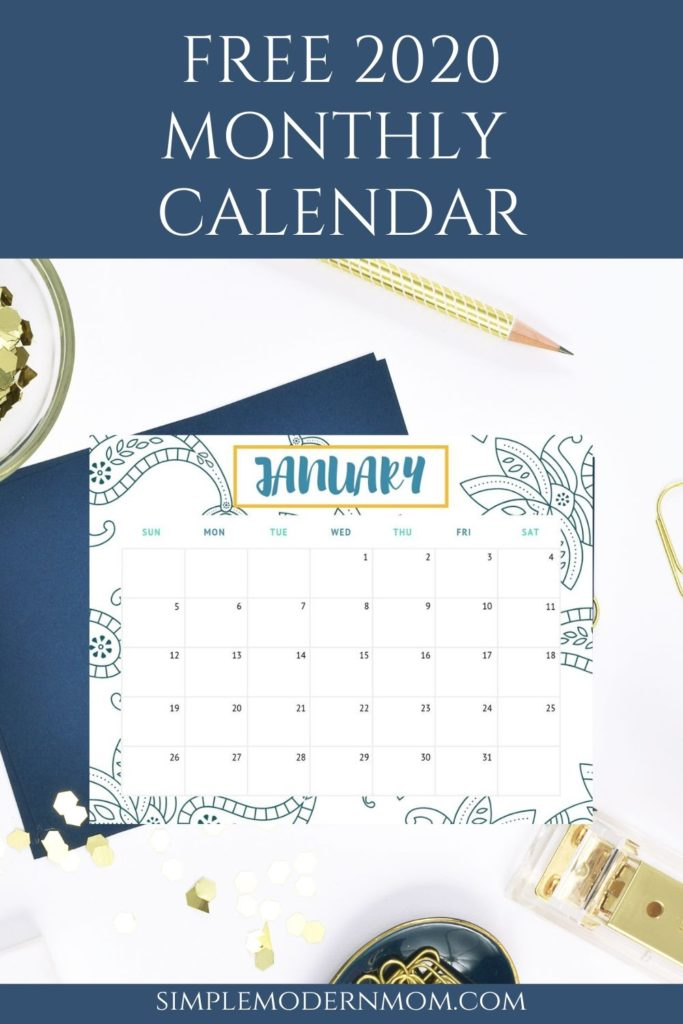 blue, white, yellow january calendar on white desk with blue and gold accessories