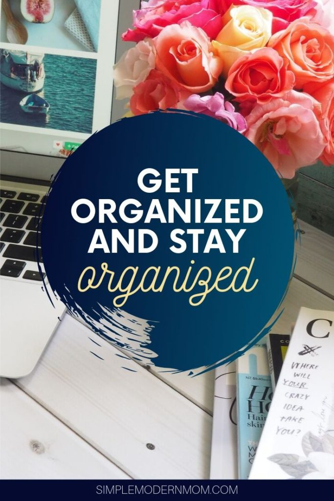 desk with laptop, roses and magazines; get organized and stay organized