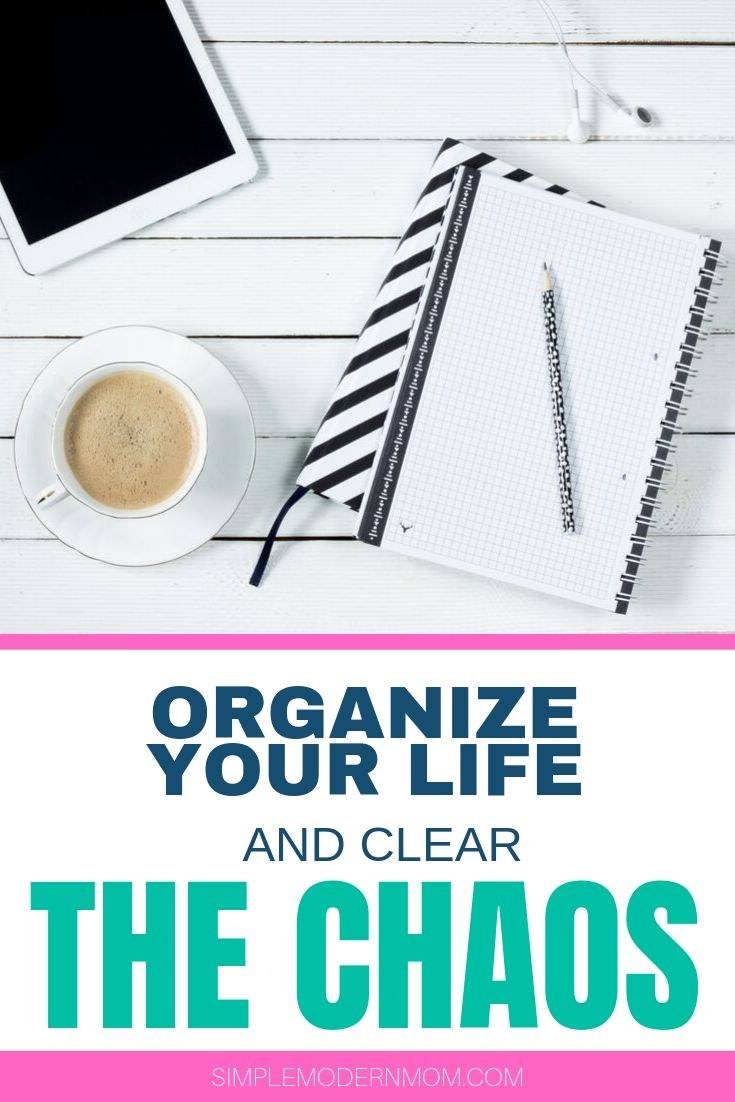 white desk with ipad, black and white striped notebook, pen, coffee and earbuds; organize your life and clear the chaos