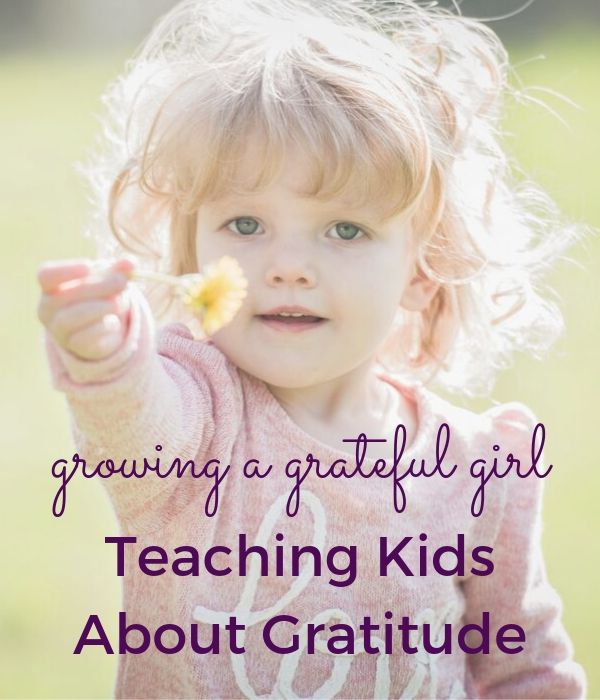 little girl with yellow flower in her hand. Growing a grateful girl; teaching kids about gratitude