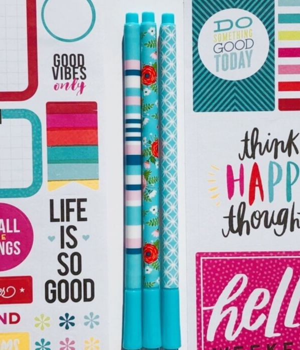 colorful journaling pens and colorful stickers