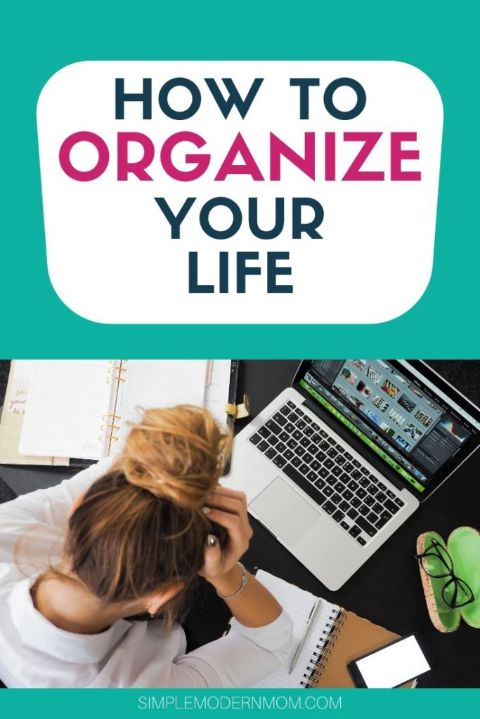 girl with head in hands, laptop, glasses with green case, phone and notebooks. How to organize your life.