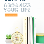 Green and white books organized on desk with green candle and plant ; 5 quick ways to organize your life