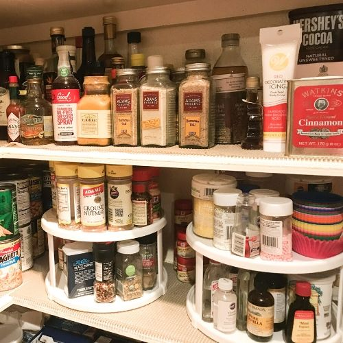 Pantry organized with baking supplies and spices on lazy susans