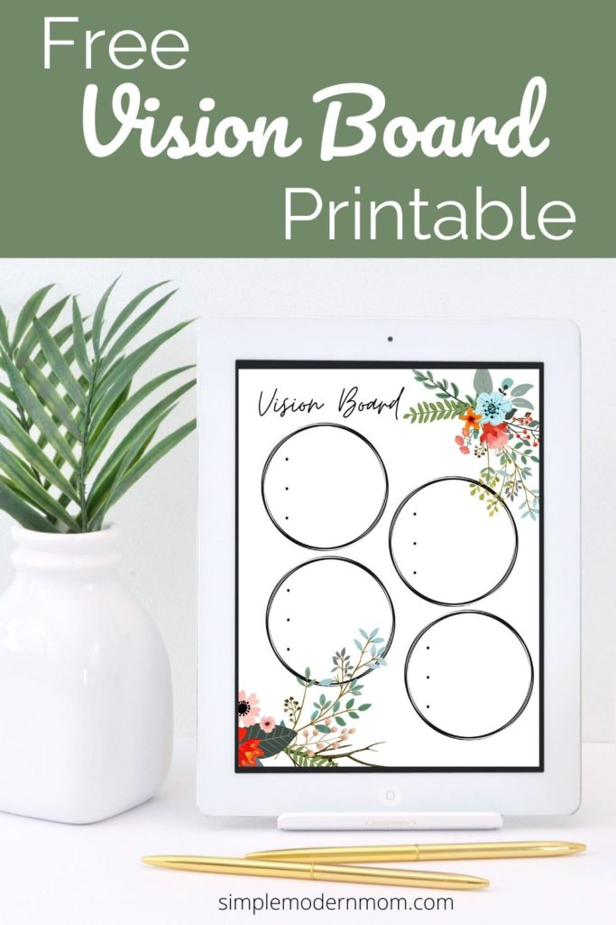 white desk with white ipad, gold pens, and green plant. free vision board printable.