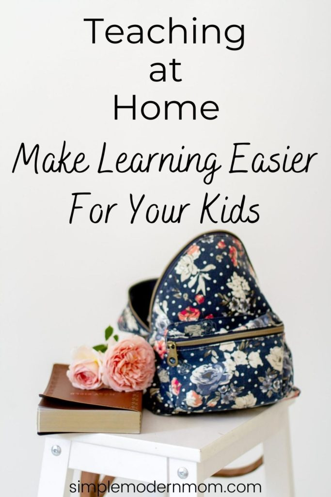 floral and navy backpack with books sitting on a stool