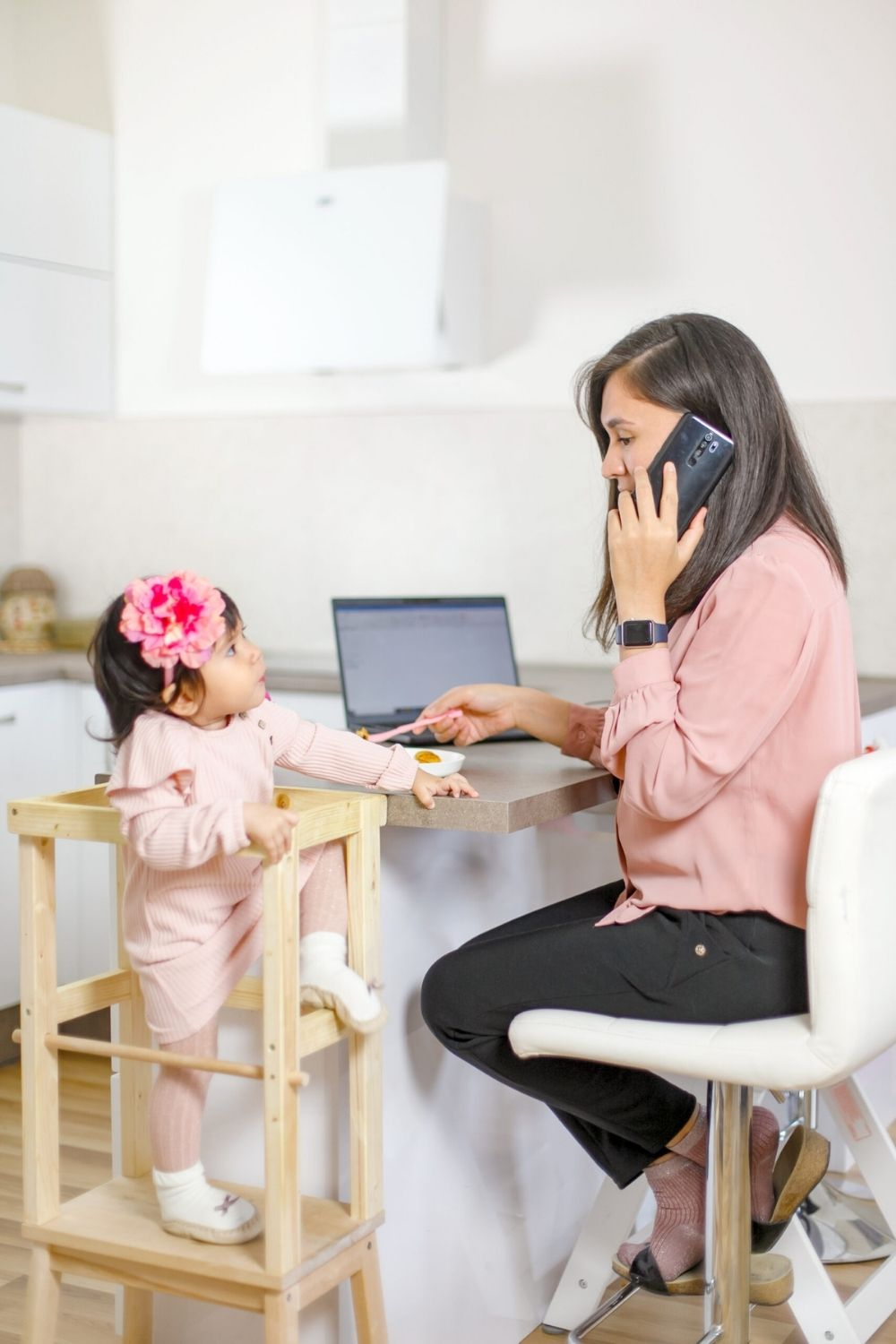 mom working from home with baby